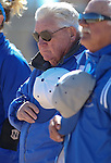 Western Nevada College assistant softball coaches Sam Herceg and Lloyd Capria listen to the National Anthem before a game at Edmonds Sports Complex in Carson City,Nev., on Friday, Feb. 21, 2014.<br /> Photo by Cathleen Allison/Nevada Photo Source