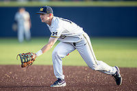Michigan Wolverines first baseman Jimmy Kerr (15) on defense against the Rutgers Scarlet Knights on April 26, 2019 in the NCAA baseball game at Ray Fisher Stadium in Ann Arbor, Michigan. Michigan defeated Rutgers 8-3. (Andrew Woolley/Four Seam Images)