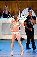 "Miami Dolphins Cheerleader, Samantha, walks runway with Darryl ""D.M.C."" McDaniels from Run DMC at Miami Dolphins Cheerleaders 2013 Swimsuit Calendar Unveiling Fashion Show at LIV Nightclub in The Fontainebleau Miami Beach Hotel, Miami Beach, FL on August 26, 2012"
