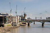 View along the River Thames from the Millenium Bridge towards Tower Bridge showing cranes on City of London contruction sites.