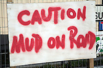 Sign Caution Mud on Road