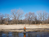 OutdoorLife Editor Andrew McKean (cq) crosses an ice filled river in search of an injured deer during a hunt for white tail deer in Superior, Nebraska, Friday, December 2, 2011. ..Photo by Matt Nager