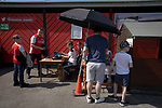 Fans arriving at the ground before Ilkeston Town host Walsall Wood in a Midland Football League premier division match at the New Manor Ground, Ilkeston. The home team were formed in 2017 taking the place of Ilkeston FC which had been wound up earlier that year. Watched by a crowd of 1587, their highest of the season, the match was top versus second, however, the visitors won 4-0 and replaced their hosts at the top of the division on goal difference with two matches to play