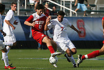 15 November 2009: NC State's Alan Sanchez (10) and Virginia's Neil Barlow (7). The University of Virginia Cavaliers defeated the North Carolina State University Wolfpack at WakeMed Stadium in Cary, North Carolina in the Atlantic Coast Conference Men's Soccer Tournament Championship game.