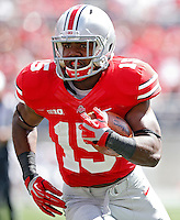 Ohio State Buckeyes running back Ezekiel Elliott (15) scores on a 16 yard touchdown run against Florida A&M Rattlers in the 3rd quarter during their college football game at Ohio Stadium on September 21, 2013.  (Dispatch photo by Kyle Robertson)