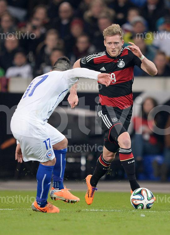 FUSSBALL INTERNATIONALES TESTSPIEL in Stuttgart Deutschland - Chile         05.03.2014 Andre Schuerrle (Deutschland,re) gegen Gary Medel (Chile,li)
