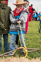 NWA Democrat-Gazette/ANTHONY REYES &bull; @NWATONYR<br /> Kaylor Bowers, first grader at George Elemenatry School, lassos a straw cow Thursday, April 23, 2015 at the annual Stick Horse Rodeo at Parsons Stadium in Springdale. The students participated in a number of activities with a rodeo theme including roping, stick horse riding, music and riding a bucking barrel.