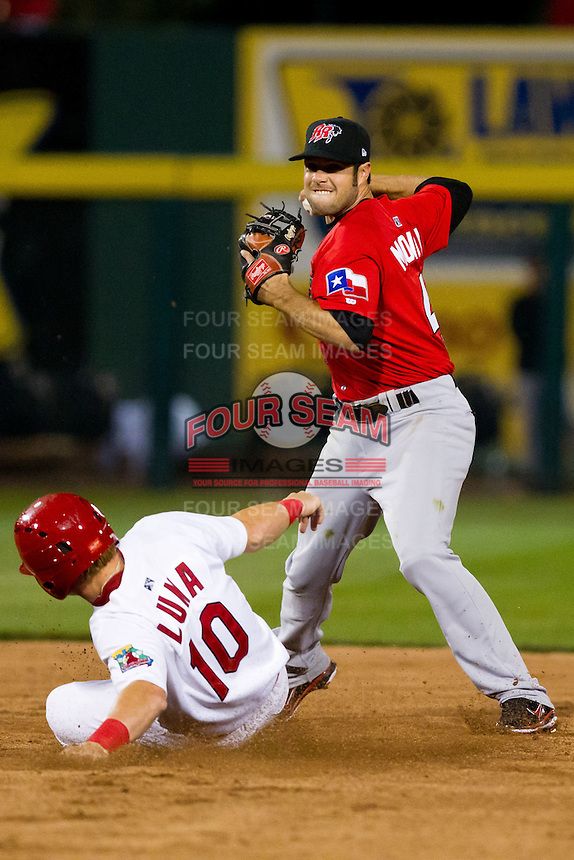 Erik Morrison (46) of the Frisco RoughRiders turns a double play during a game against the Springfield Cardinals on April 14, 2011 at Hammons Field in Springfield, Missouri.  Photo By David Welker/Four Seam Images.