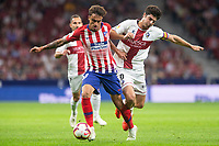 C. Isaac of Atletico Madrid and Melero of SD Huesca during the match between Atletico Madrid v SD Huesca of LaLiga, 2018-2019 season, date 6. Wanda Metropolitano Stadium. Madrid, Spain - 25 September 2018. Mandatory credit: Ana Marcos / PRESSINPHOTO