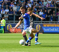 Lincoln City's Harry Toffolo vies for possession with Carlisle United's Stefan Scougall<br /> <br /> Photographer Chris Vaughan/CameraSport<br /> <br /> The EFL Sky Bet League Two - Carlisle United v Lincoln City - Friday 19th April 2019 - Brunton Park - Carlisle<br /> <br /> World Copyright © 2019 CameraSport. All rights reserved. 43 Linden Ave. Countesthorpe. Leicester. England. LE8 5PG - Tel: +44 (0) 116 277 4147 - admin@camerasport.com - www.camerasport.com