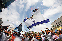 Members of several Islamic political parties of Bangladesh burn an Israeli flag. Today thousand of activists march in a procession in front of the Baitul Mukarram National Mosque to protest against Israeli attack on Gaza. Dhaka, Bangladesh