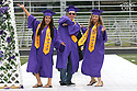 More than 390 students crossed the stage Friday night for the North Kitsap High School graduation. Lauren Gallegos, Christopher Harrel adn Samantha Able walk into the stadium Friday. (Brad Camp/ Olympic Photo Group)