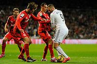 Real Madrid´s Karim Benzema and Sevilla's Grzegorz Krychowiak during 2014-15 La Liga match between Real Madrid and Sevilla at Santiago Bernabeu stadium in Alcorcon, Madrid, Spain. February 04, 2015. (ALTERPHOTOS/Luis Fernandez) /NORTEphoto.com