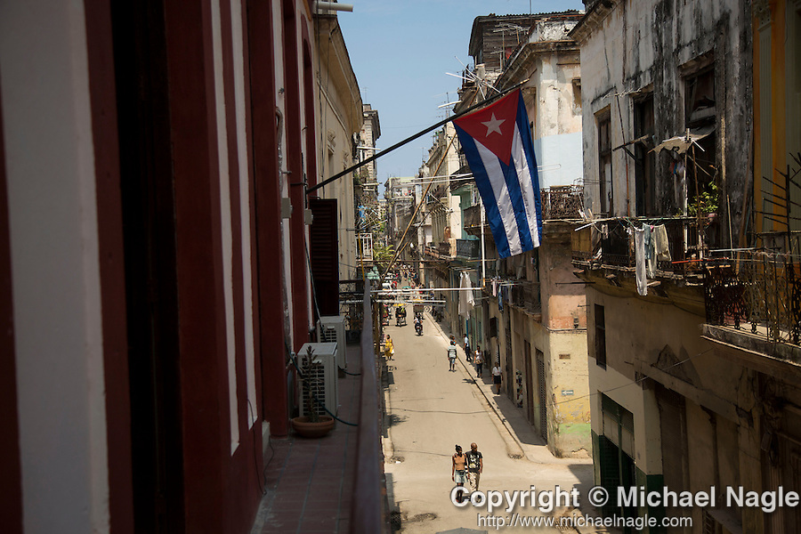 HAVANA, CUBA -- MARCH 25, 2015:   People walk through the Havana Vieja neighborhood in Havana, Cuba on March 25, 2015. Photograph by Michael Nagle