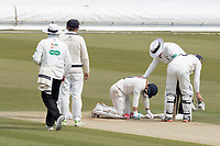 The umpire and players seek to assist Rob Jones of Lancashire CCC after he is felled by James Harris delivery during Middlesex CCC vs Lancashire CCC, Specsavers County Championship Division 2 Cricket at Lord's Cricket Ground on 13th April 2019