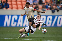 Houston, TX -  Sunday, December 11, 2016: Tanner Beason (3) of the Stanford Cardinal attempts to strip the ball from Jacori Hayes (8) of the Wake Forest Demon Deacons at the  NCAA Men's Soccer Finals at BBVA Compass Stadium.