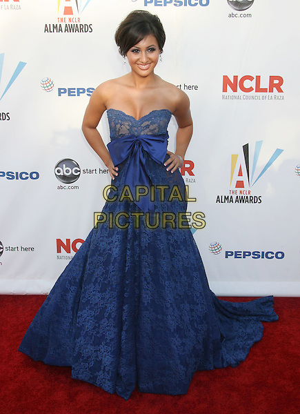 FRANCIA RAISA.2009 ALMA Awards held at Royce Hall on the UCLA Campus, Westwood, CA, USA..September 17th, 2009.full length blue strapless lace dress gown hand on hip bow sash.CAP/ADM/MJ.©Michael Jade/AdMedia/Capital Pictures.