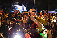 REVISED CAPTION : Vietnamese people celebrate Vietnam victory over Malaysia at the AFF (football) Suzuki cup game, December 11, 2018.