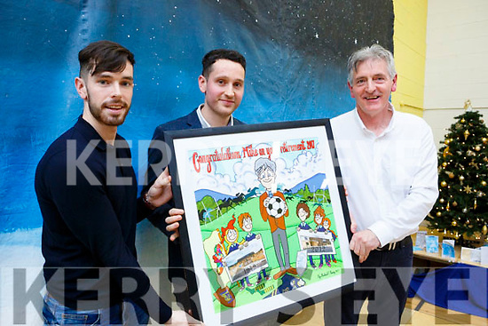Kevin and Michael Sweeny presents their dad, Mike Sweeney with a framed momento as he retires as Principal of Scoil Naisiúnta Uaimh Bhreannain(O'Brennan National School), Kielduff.