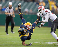 Keenan Allen of California gets tackled by Deone Bucannon of Washington State during the game at AT&T Park in San Francisco, California on November 5th, 2011.  California defeated Washington State, 30-7.
