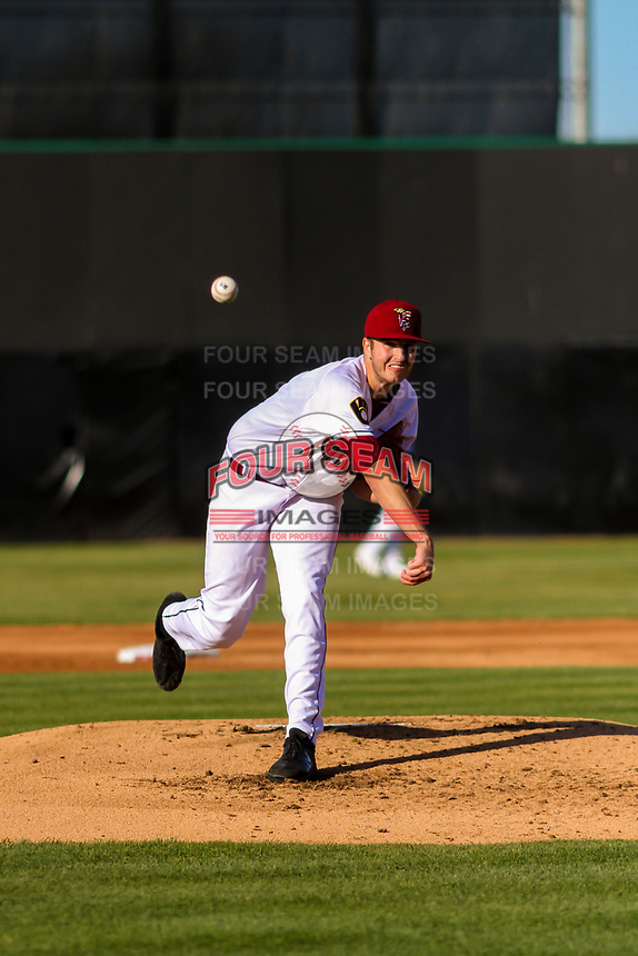 Wisconsin Timber Rattlers pitcher Adam Hill (15) delivers a warmup pitch between innings during a Midwest League game against the Burlington Bees on April 26, 2019 at Fox Cities Stadium in Appleton, Wisconsin. Wisconsin defeated Burlington 2-0. (Brad Krause/Four Seam Images)