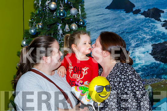 Emily Reardan Caherciveen with her mum Davina gives her aunt Marie Gibbons a peck on her return home for Christmas at Kerry Airport on Monday