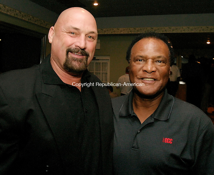 WATERBURY, CT - 08 OCTOBER 2005 -100805JS04--Former NFL players Jim Weatherley, left and Booker Edgerson at the reception for the Bobby Bonds Golf Tournament at Western Hills Golf Course in Waterbury on Saturday. The tournament, in concert with New Opportunities, Inc. Afro-Latin Indian Scholarship Program has raised more than $333,000 for are young people.   --Jim Shannon / Republican-American  --Jim Weatherley; Booker Edgerson, Bobby Bonds Golf Tournament, Western Hills Golf Course, Waterbury, New Opportunities, Inc. are CQ