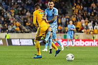 HARRISON, NJ - MARCH 11: Alexandru Mitrita #28 of NYCFC collides with Hugo Ayala #4 of Tigres UANL during a game between Tigres UANL and NYCFC at Red Bull Arena on March 11, 2020 in Harrison, New Jersey.