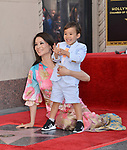 Lucy Liu Honored With Star On The Hollywood Walk Of Fame on May 01, 2019 in Hollywood, California.<br /> a_Lucy Liu 003 and son