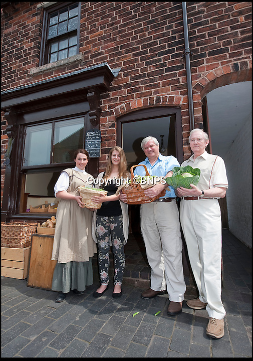 BNPS.co.uk (01202 558833)<br /> Pic: PhilYeomans/BNPS<br /> <br /> Re-Open All Hours...<br /> <br /> Jim(85), Andrew(52) and Melanie(22) Adey outside their old shop with a museum guide in the Edwardian dress their ancestors would have worn.<br /> <br /> Three generations of the Adey family outside the tiny shop their Edwardian ancesters ran in the West Midlands.<br /> <br /> A greengrocers shop in a Victorian two up two down has been reunited with the family that once owned it after it was painstakingly rebuilt at the Black Country Living Museum in Dudley.<br /> <br /> The turn-of-the-century greengrocers shop has re-opened for business almost a 100 years after it served its first customers - and it is an exact replica of how it used to be.<br /> <br /> Plucky housewife Gertrude Adey transformed her modest front room into a fruit and veg shop in 1916 to earn a few shillings so she could survive while husband William was off fighting in the First World War.<br /> <br /> In 1995 the historic building was demolished to pave the way for a new development in the town centre but 98 years after it first opened the shop is back in business after it was lovingly rebuilt brick by brick.<br /> <br /> The humble shop will only sell produce that was available at the time and any left over fruit and veg will be turned into pickles, chutneys and jams, just like it would have been back in the early 20th century.<br /> <br /> And staff will even be dressed in plain period clothing just as William and Gertrude would have worn. <br /> <br /> The opening of the time-warp shop is the culmination of a project by local historians who rebuilt the shop in the grounds of the Black Country Living open air museum.<br /> <br /> Three generations of the Adey family - William's grandson Jim, 85, great grandson Andrew, 54, and great-great granddaughter Melanie, 22 - officially opened the shop on Saturday.