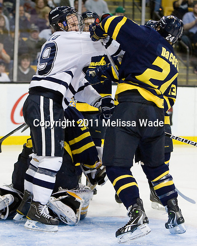 Mike Sislo (UNH - 19), Stephane Da Costa (Merrimack - 24) - The Merrimack College Warriors defeated the University of New Hampshire Wildcats 4-1 (EN) in their Hockey East Semi-Final on Friday, March 18, 2011, at TD Garden in Boston, Massachusetts.
