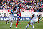 Atletico de Madrid´s Mandzukic (C) and Deportivo de la Coruña´s Insua (L) during 2014-15 La Liga match between Atletico de Madrid and Deportivo de la Coruña at Vicente Calderon stadium in Madrid, Spain. November 30, 2014. (ALTERPHOTOS/Victor Blanco)