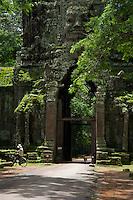 Moss coverd sone heads at the gate of the Bayon Temple, Cambodia