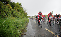 Kenny Dehaes (BEL/Lotto-Belisol) &amp; Dennis Vanendert (BEL/Lotto-Belisol) practically have to ride with their eyes closed in these superwet conditions<br /> <br /> Giro d'Italia 2014<br /> stage 3: Armagh - Dublin 187km