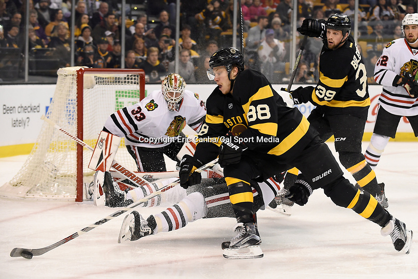 Thursday, March 3, 2016: Boston Bruins left wing David Pastrnak (88) gets control of the puck during the National Hockey League game between the Chicago Blackhawks and the Boston Bruins, held at TD Garden, in Boston, Massachusetts. Eric Canha/CSM