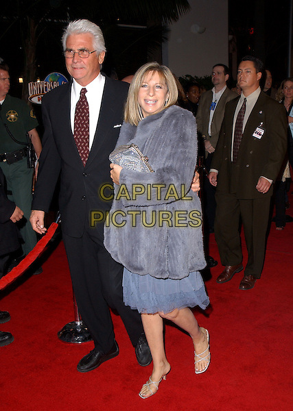 "JAMES BROLIN & BARBARA STREISAND.Universal Pictures' Premiere of ""Meet The Fockers"" held at Universal City Walk in Universal City, California  December 16th, 2004.full length, celebrity couple, black suit, purple fur coat, jacket, clutching purse, bag.www.capitalpictures.com.sales@capitalpictures.com.Supplied By Capital PIctures"