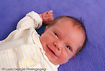 2 week old newborn baby boy closeup alert smiling horizontal
