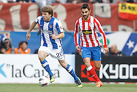 02.05.2012 SPAIN -  La Liga matchday 20th  match played between Atletico de Madrid vs Real Sociedadl (1-1) at Vicente Calderon stadium. The picture show  Asier Illarramendi Andonegi (Midfielder of Real Sociedad) and Adrian Lopez Alvarez (Spanish striker of At. Madrid)