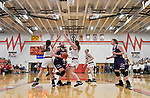 Civic Memorial forward Anna Hall drives between Highland players Megan Kronk (left) and Bella LaPorta (right). Highland played Civic Memorial in the Class 3A Effingham sectional championship game at Effingham High School in Effingham, Illinois on Thursday February 27, 2020. <br /> Tim Vizer/Special to STLhighschoolsports.com