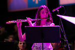 Emily Jeanne DePalma performs a piece by 19th century composer Camille Saint-Saëns Saturday, June 10, 2017, during the DePaul University School of Music and The Theatre School commencement ceremony at the Rosemont Theatre in Rosemont, IL. (DePaul University/Jeff Carrion)