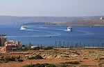 View from Cirkewwa two ferry ships Gozo Channel Line between Gozo and Malta passing island of Comino