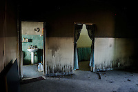 Tripoli, Libya, March 29, 2011..Fallout from Coalition air strike on a Libyan army ammunition depot 5km from Mizdah, a small isolated desert town 200km south of Tripoli caused some collateral damage on houses, including the appartment of a Korean doctor at the local hospital, he was severely injured..