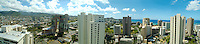 Panorama of greater Honolulu, with buildings and condos stretching to Waikiki and the hillsides crowded with local neighborhoods.