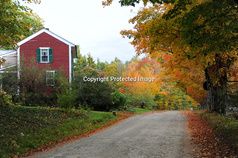 Farmstead on a Country Dirt Road during Fall Season in Lempster, New Hampshire USA