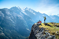 Taking a break to relax and look at the view of the Dom, while trail running the Via Valais, a multi-day trail running tour connecting Verbier with Zermatt, Switzerland.