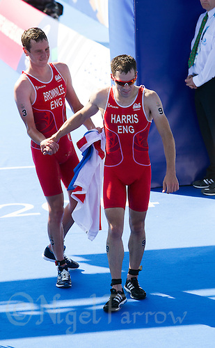24 JUL 2014 - GLASGOW, GBR - Aaron Harris (ENG) (right) shakes hands with race winner England team mate Alistair Brownlee (ENG) (left) after finishing the elite men's 2014 Commonwealth Games triathlon in Strathclyde Country Park in Glasgow, Scotland (PHOTO COPYRIGHT &copy; 2014 NIGEL FARROW, ALL RIGHTS RESERVED)<br /> *******************************<br /> COMMONWEALTH GAMES <br /> FEDERATION USAGE <br /> RULES APPLY<br /> *******************************