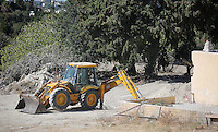 Pictured: A digger operates on the ground where the extension to the farmhouse was, where Ben Needham disappeared from in Kos, Greece. Friday 07 October 2016<br />