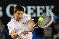 MELBOURNE, 29 JANUARY - Novak Djokovic (SRB) in action against Rafael Nadal (ESP) during the men's finals match on day 14 of the 2012 Australian Open at Melbourne Park, Australia. (Photo Sydney Low / syd-low.com)
