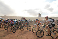 Racers mount their bicycles after having run approximately 1/2 mile in the Lemans start of the 2007 24 hours of Moab endurance mountain biking event.