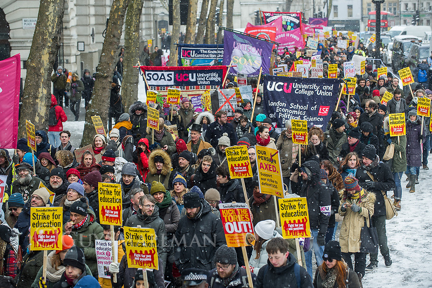 Striking lecturers from the UCU Trade Union marching with their supporters against changes to their pensions which had triggered the dispute. London 28-2-18